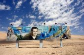 Roadside painting of bashar al assad along the damascus aleppo route